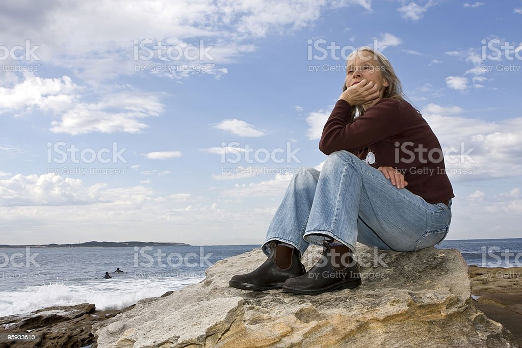 Sitting on rocks royalty-free stock photo