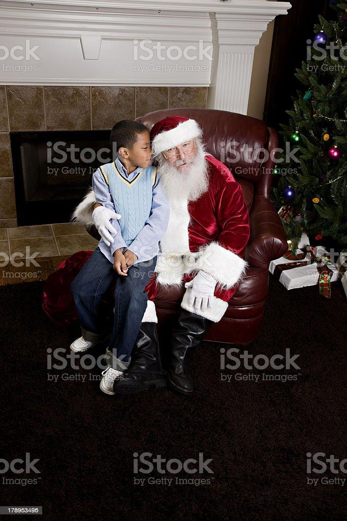Sitting on Santa Claus Lap stock photo