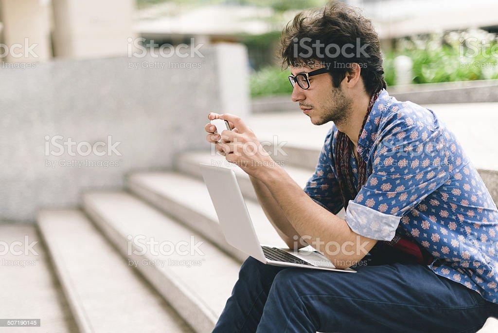 Sitting on steps stock photo
