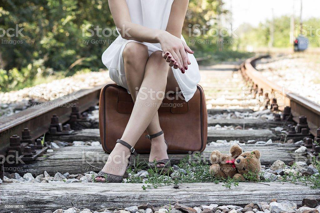 Sitting on suitcase stock photo