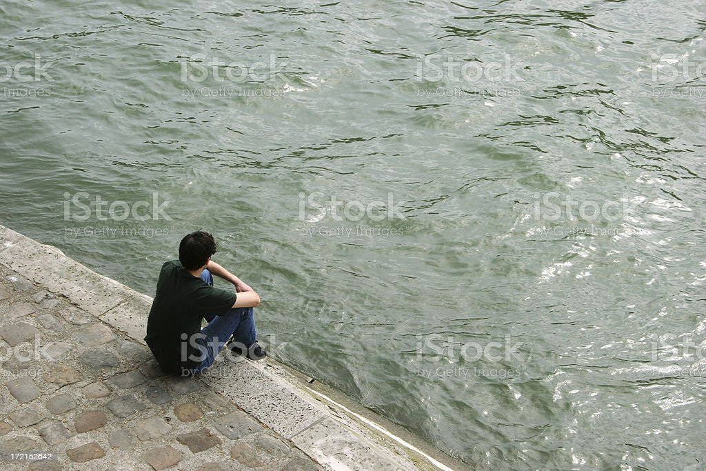sitting on the banks of Seine royalty-free stock photo
