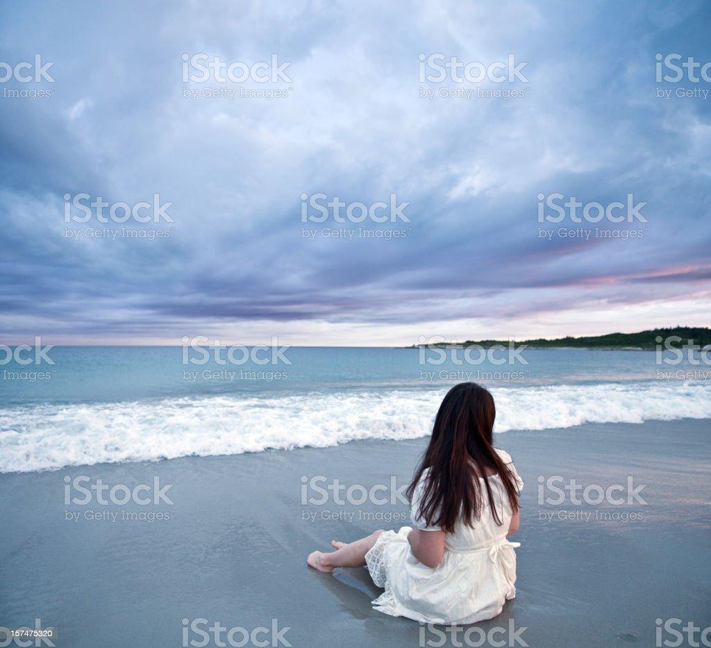 Sitting on the Beach stock photo