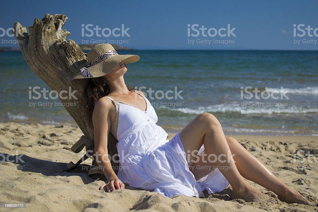 Sitting on the beach royalty-free stock photo