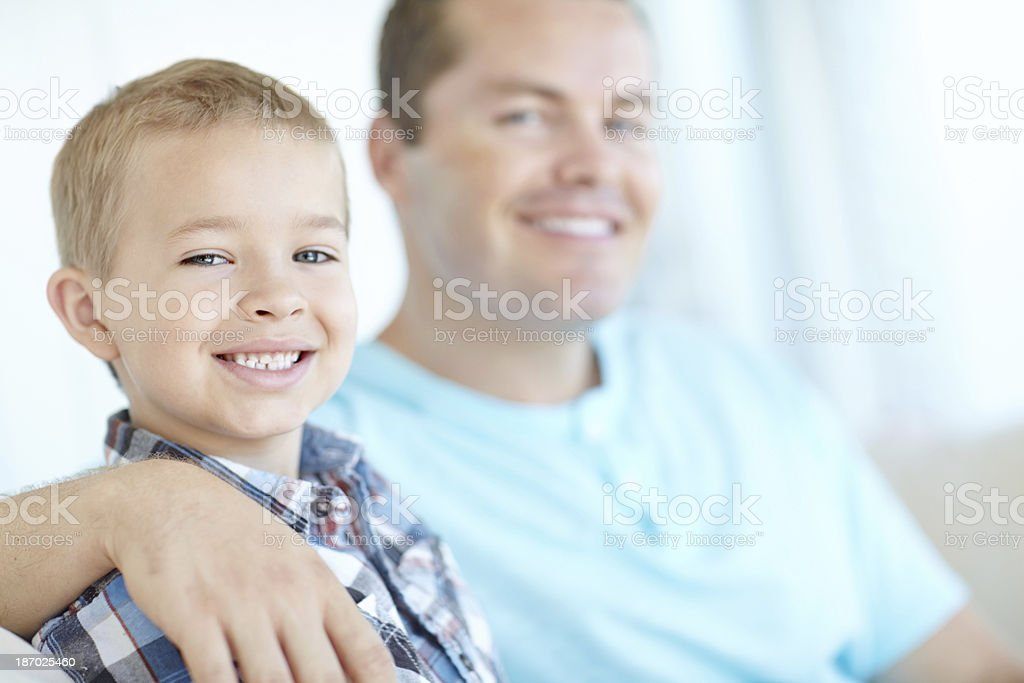 Sitting on the couch with dad royalty-free stock photo