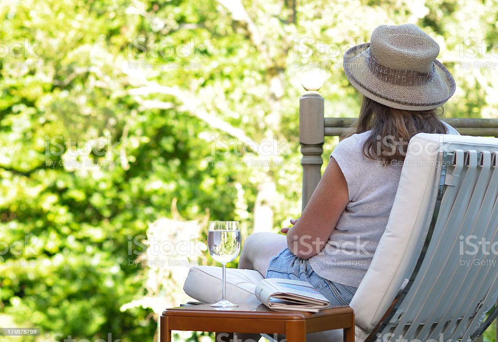 Sitting on the Decking in a Hat royalty-free stock photo