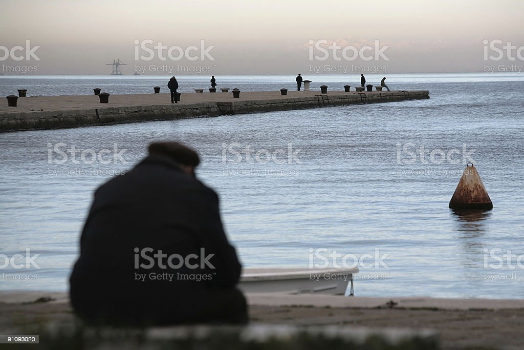sitting on the dock royalty-free stock photo