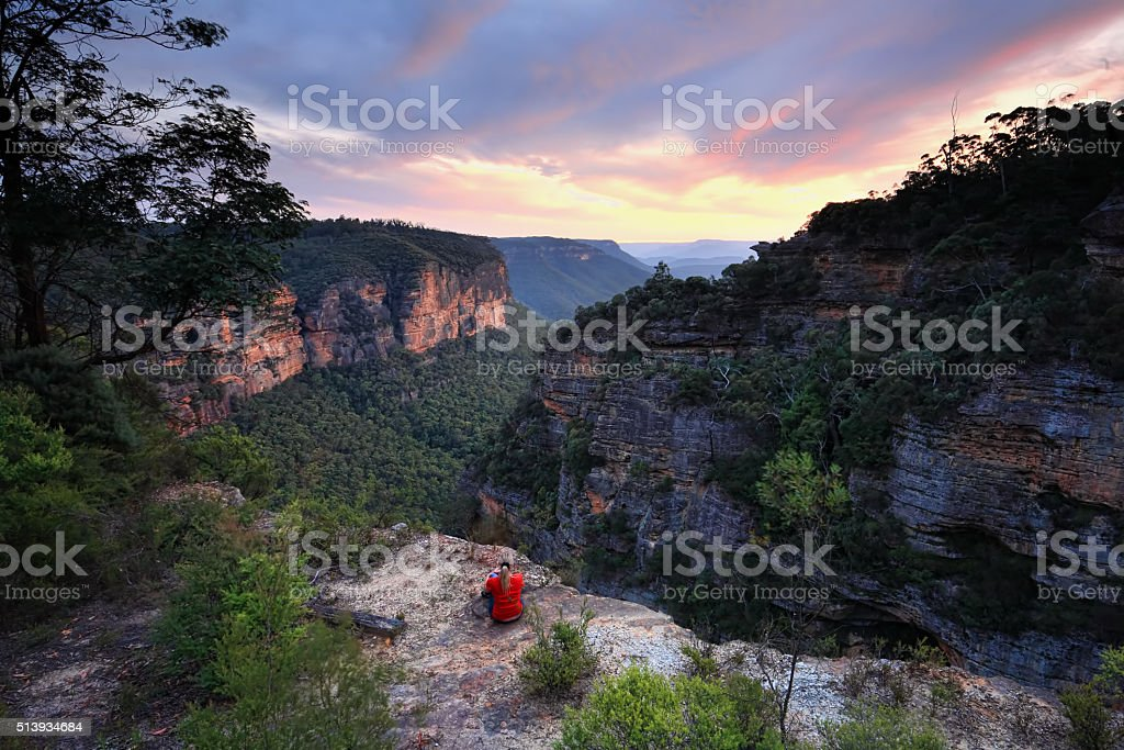 Sitting on the edge of wilderness Blue Mountains Australia stock photo
