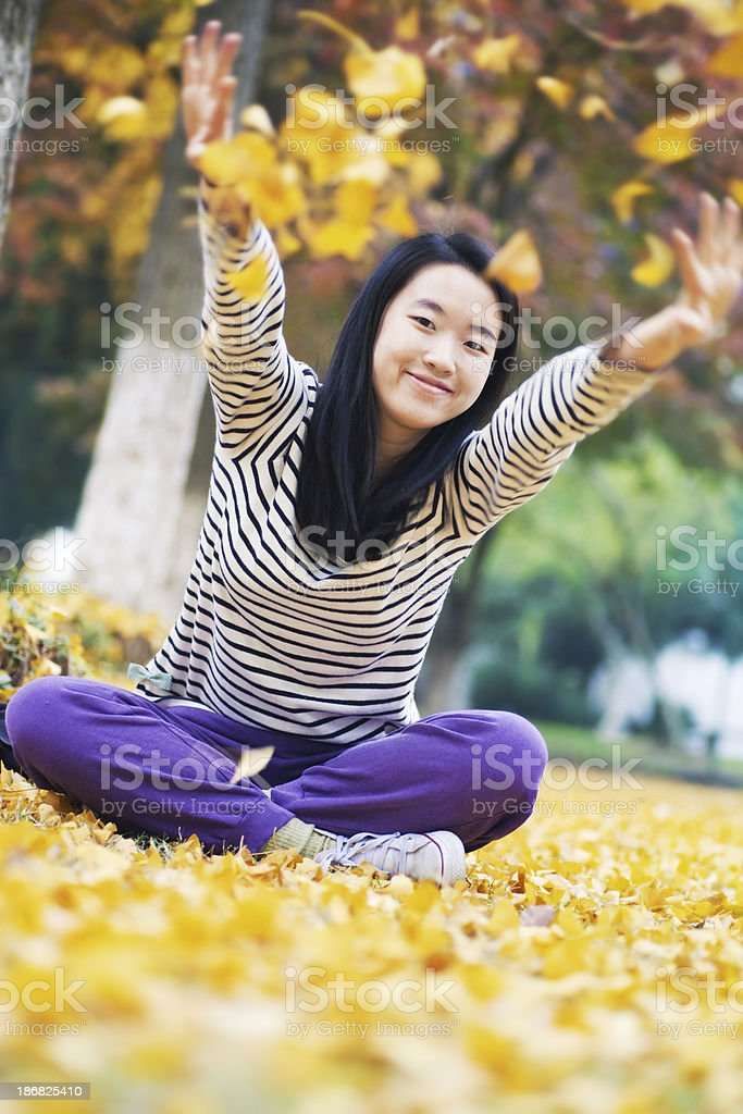 Sitting on the fallen leaves royalty-free stock photo