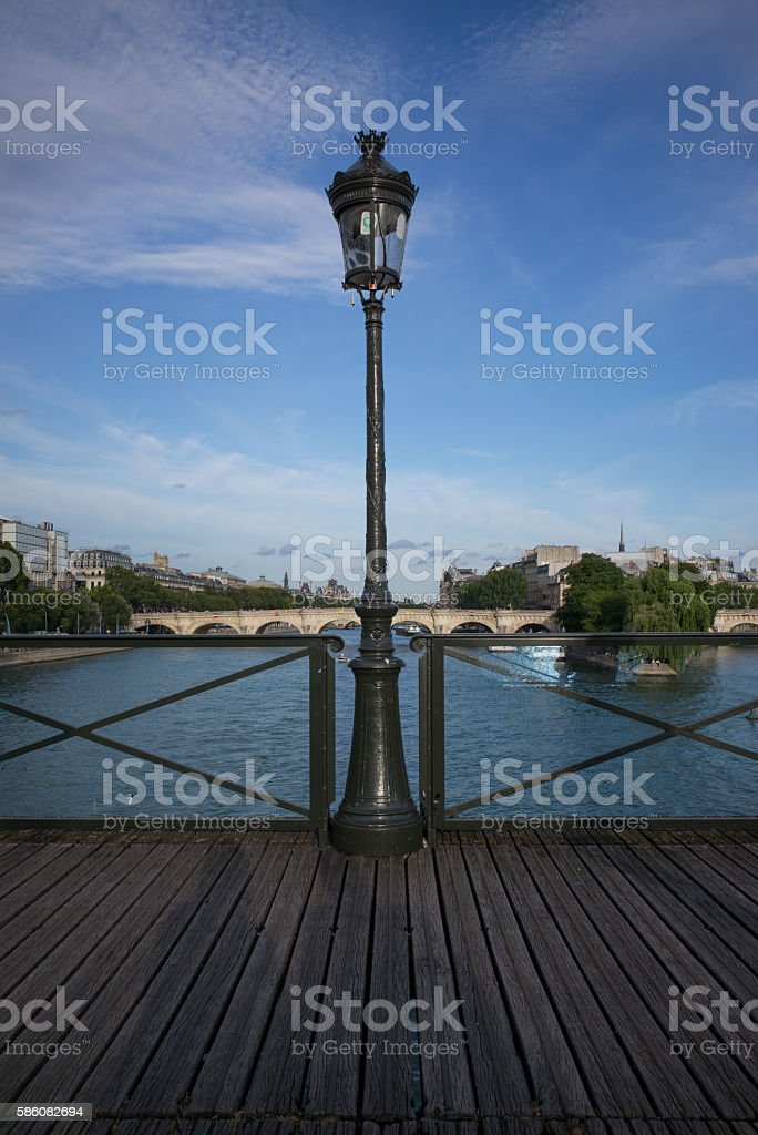 Sitting on the Pont des Arts stock photo