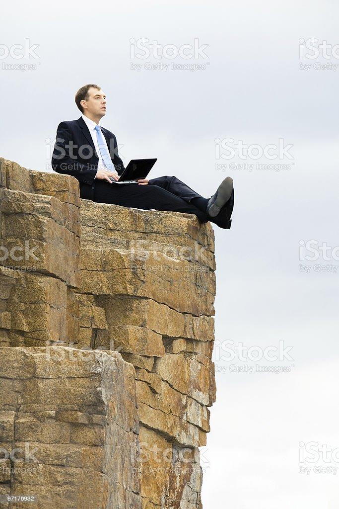 Sitting on the rocks royalty-free stock photo