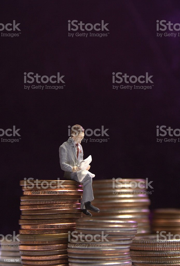 Sitting on your money royalty-free stock photo