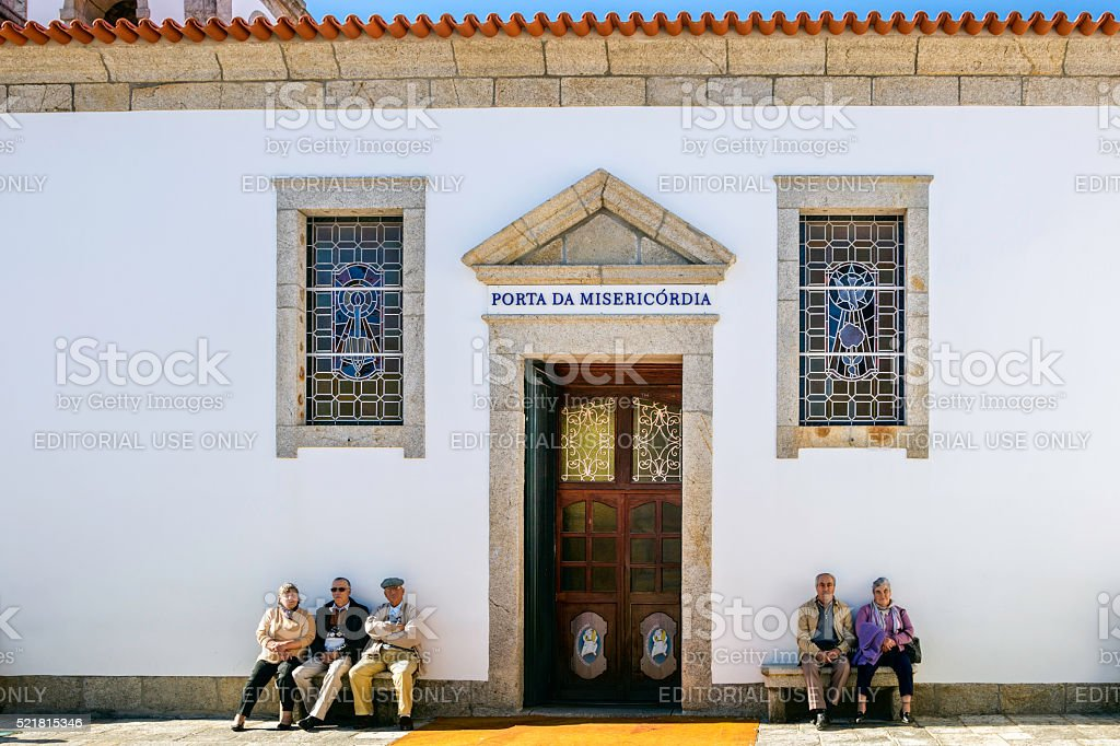 Sitting outside 'The door of mercy' stock photo