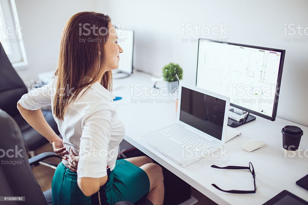 Sitting problems at the office stock photo