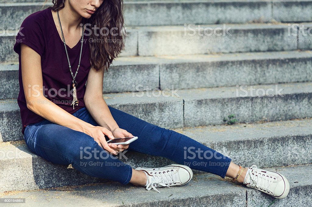 Sitting sad and alone stock photo