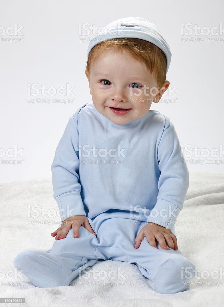 Sitting, smiling baby-8 months  in hat on head royalty-free stock photo