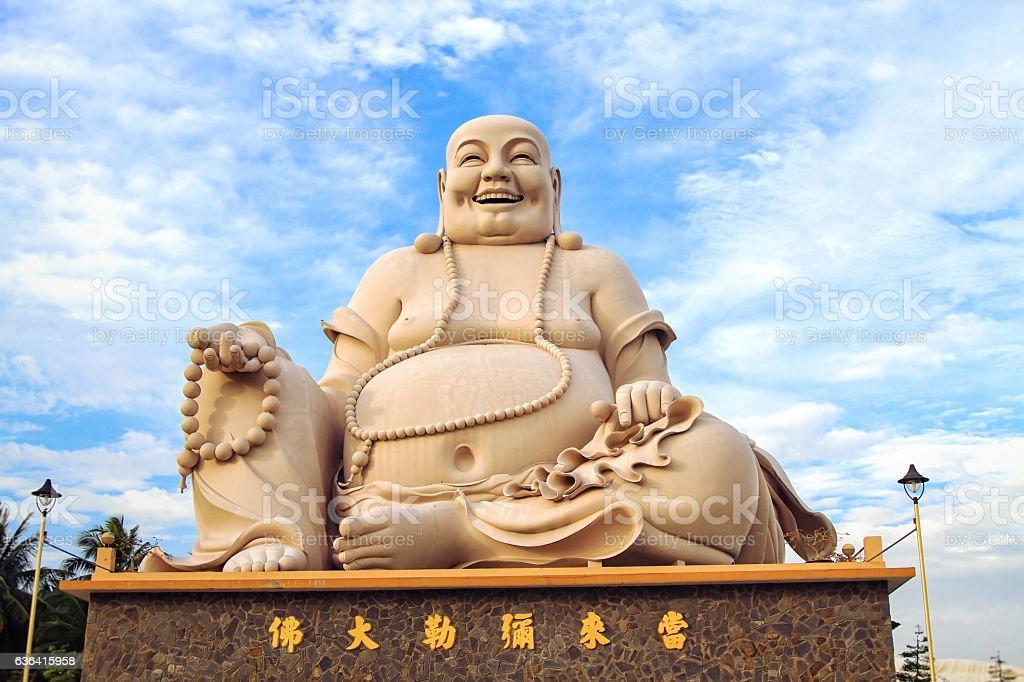 Sitting Smiling Buddha stock photo