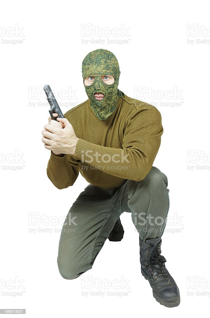 Sitting soldier with a handgun royalty-free stock photo