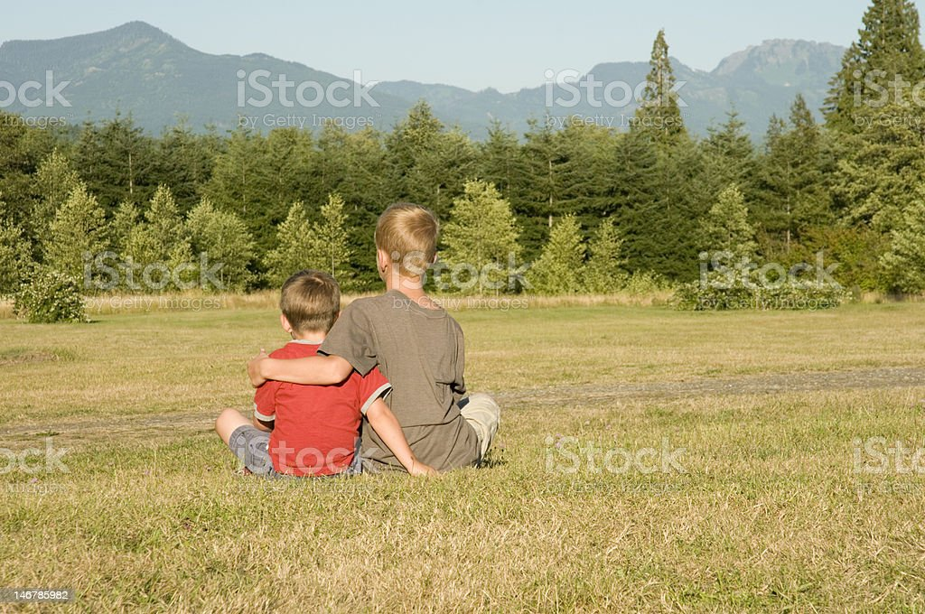 Sitting Together in the Field royalty-free stock photo