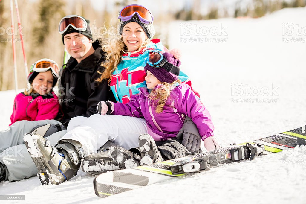 Sitting Together on Top of the Snow Hill stock photo
