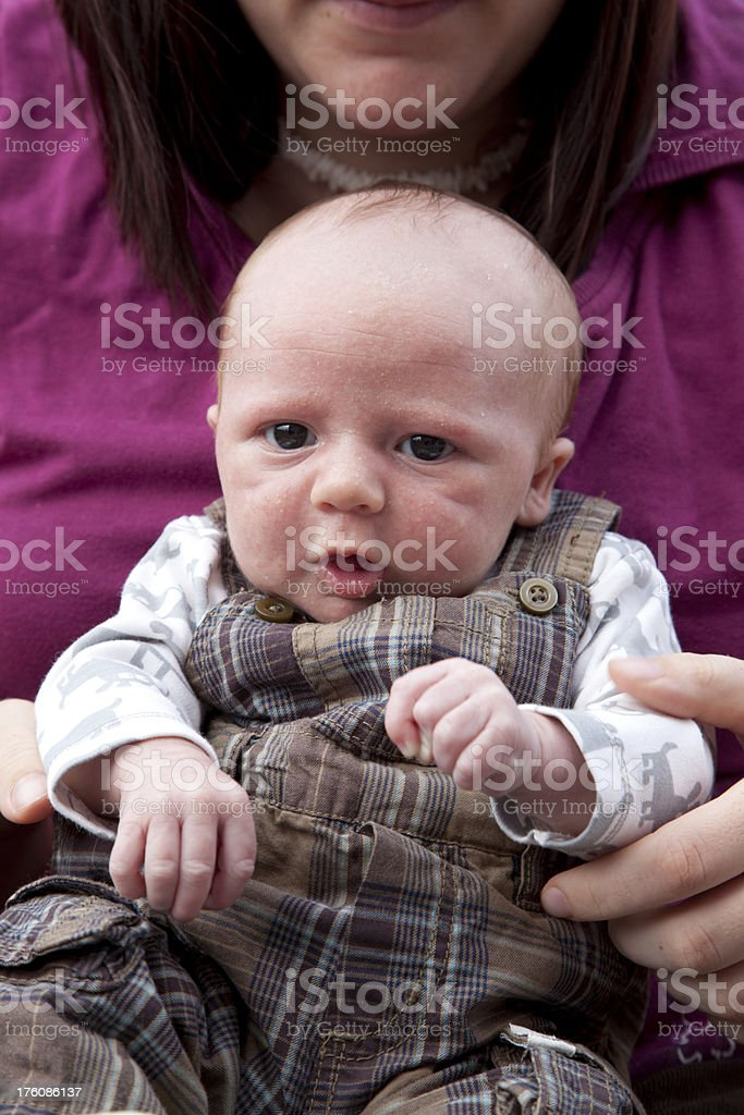Sitting with Mommy royalty-free stock photo