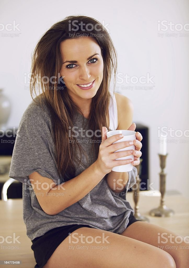 Sitting Woman at Home with Coffee stock photo