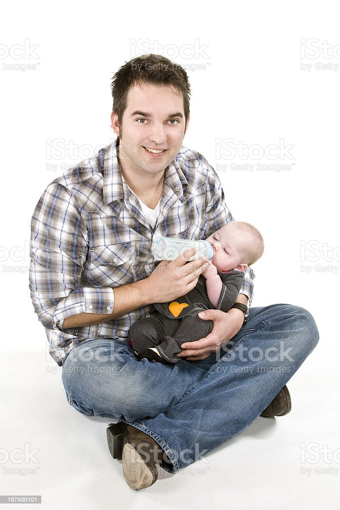 sitting young adult father feeding infant baby daughter on lap royalty-free stock photo