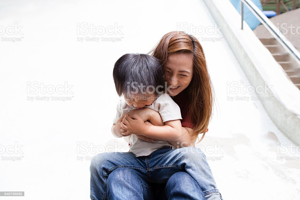 Situation in which slipped slide in parent and child stock photo