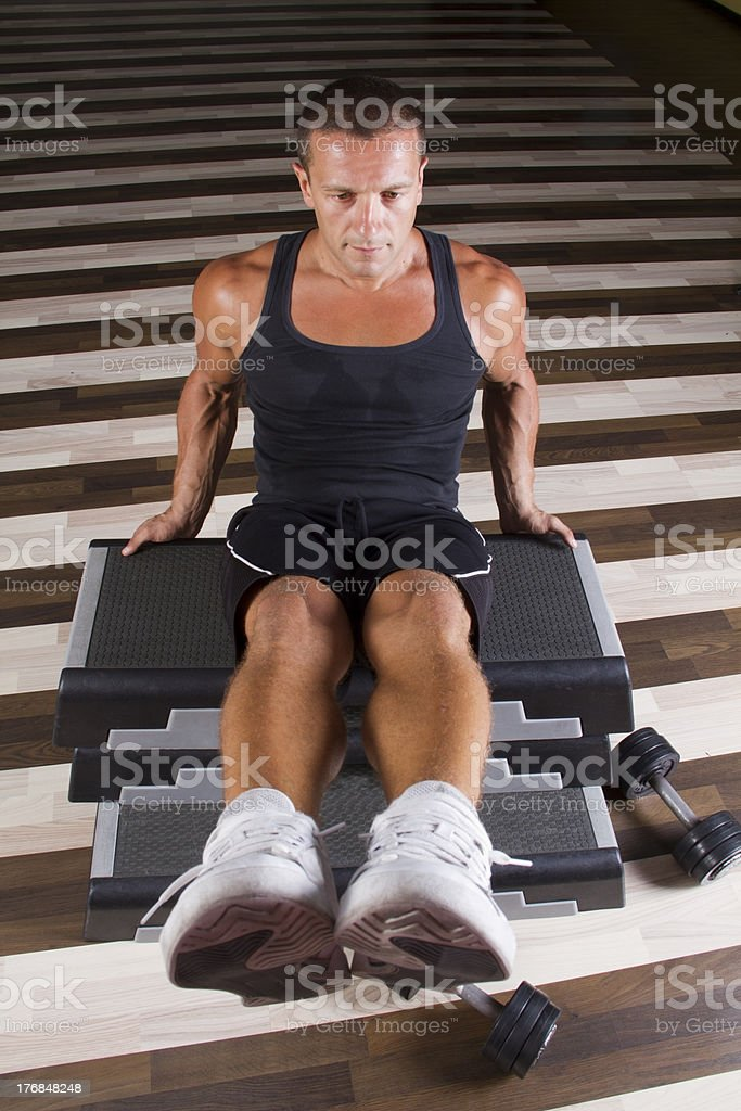 Sit-ups on the stepper stock photo