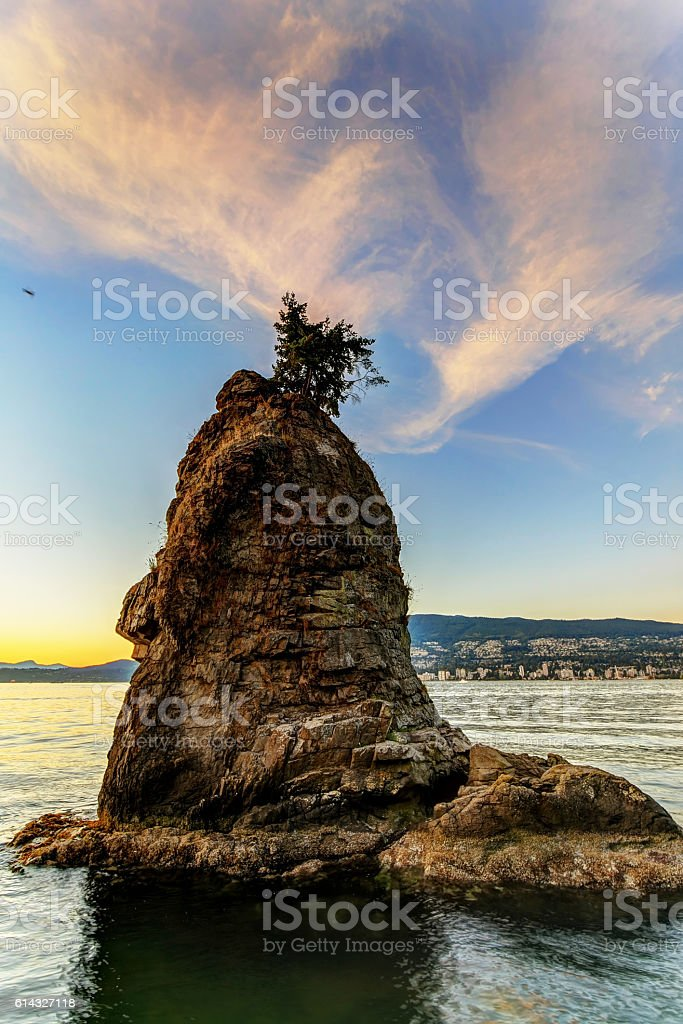 Siwash Rock with sunset background, Vancouver, BC, Canada stock photo