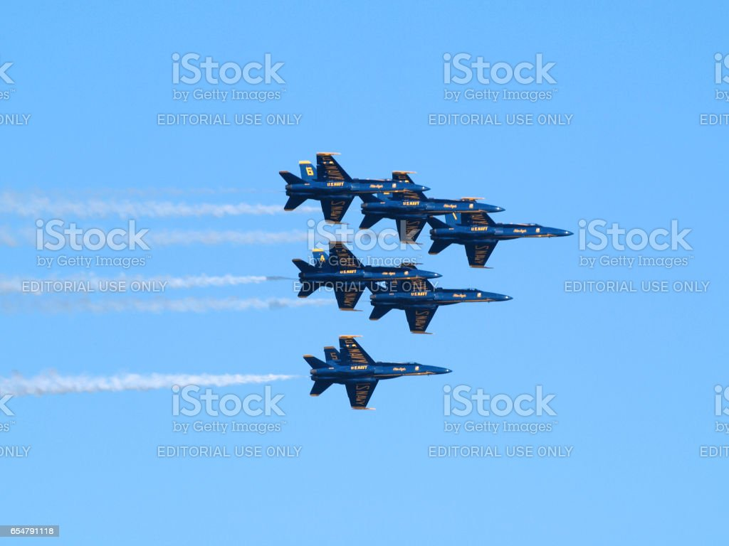 Six Blue Angels fly in tight triangle formation as afterburns fire stock photo