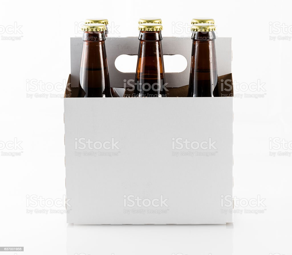Six bottles of beer in cardboard carrier stock photo