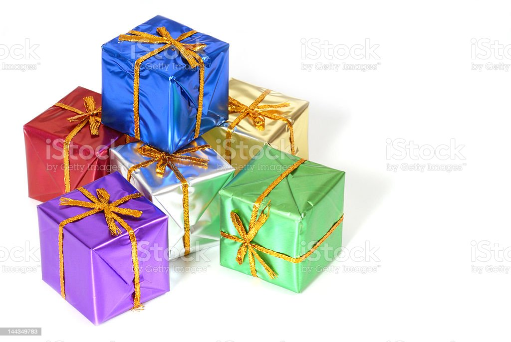 Six brightly colored wrapped Christmas packages royalty-free stock photo