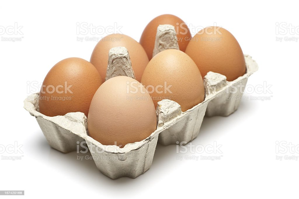 Six brown eggs in a carton isolated on white stock photo