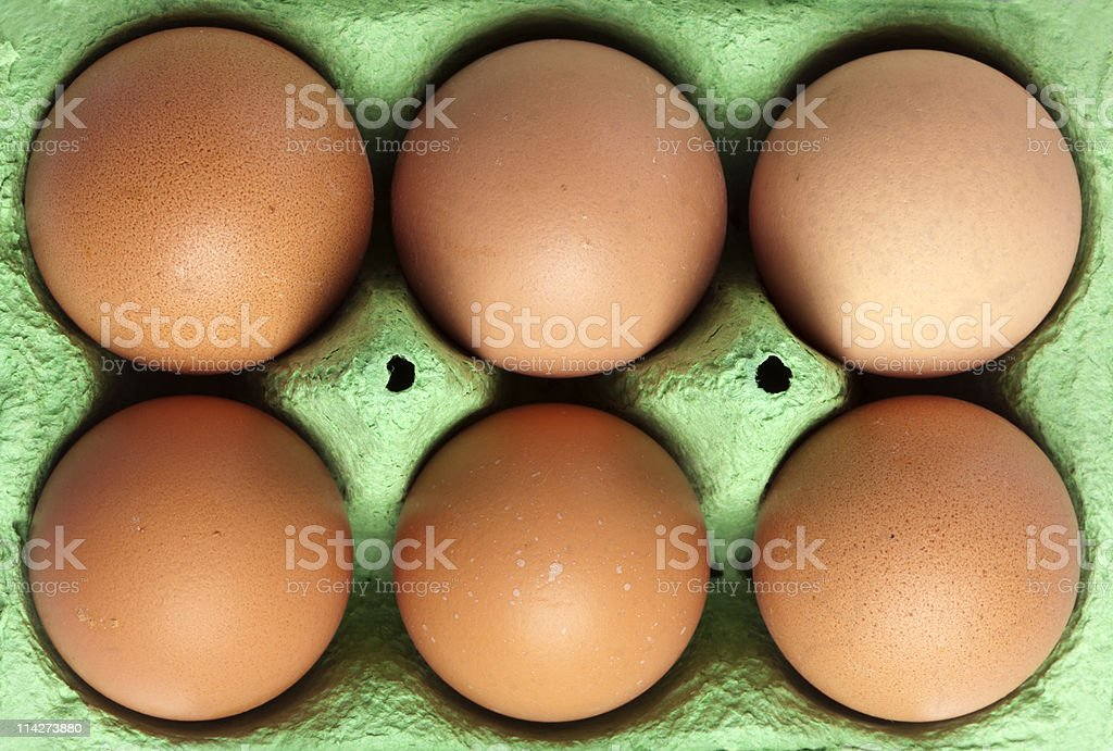 six brown eggs in the box, birds view royalty-free stock photo