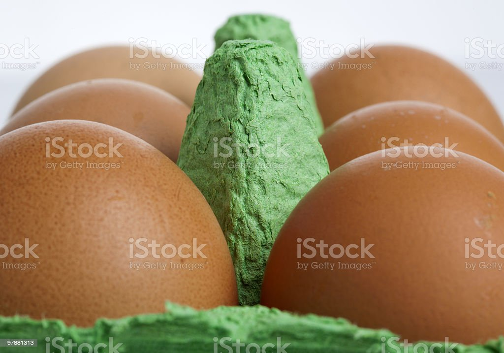 six brown eggs in the box royalty-free stock photo