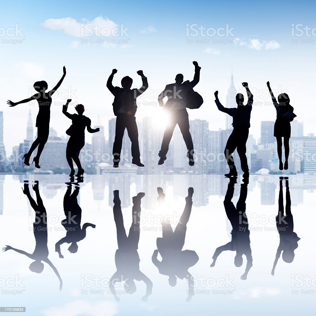 Six business people jumping in success against city skyline royalty-free stock photo