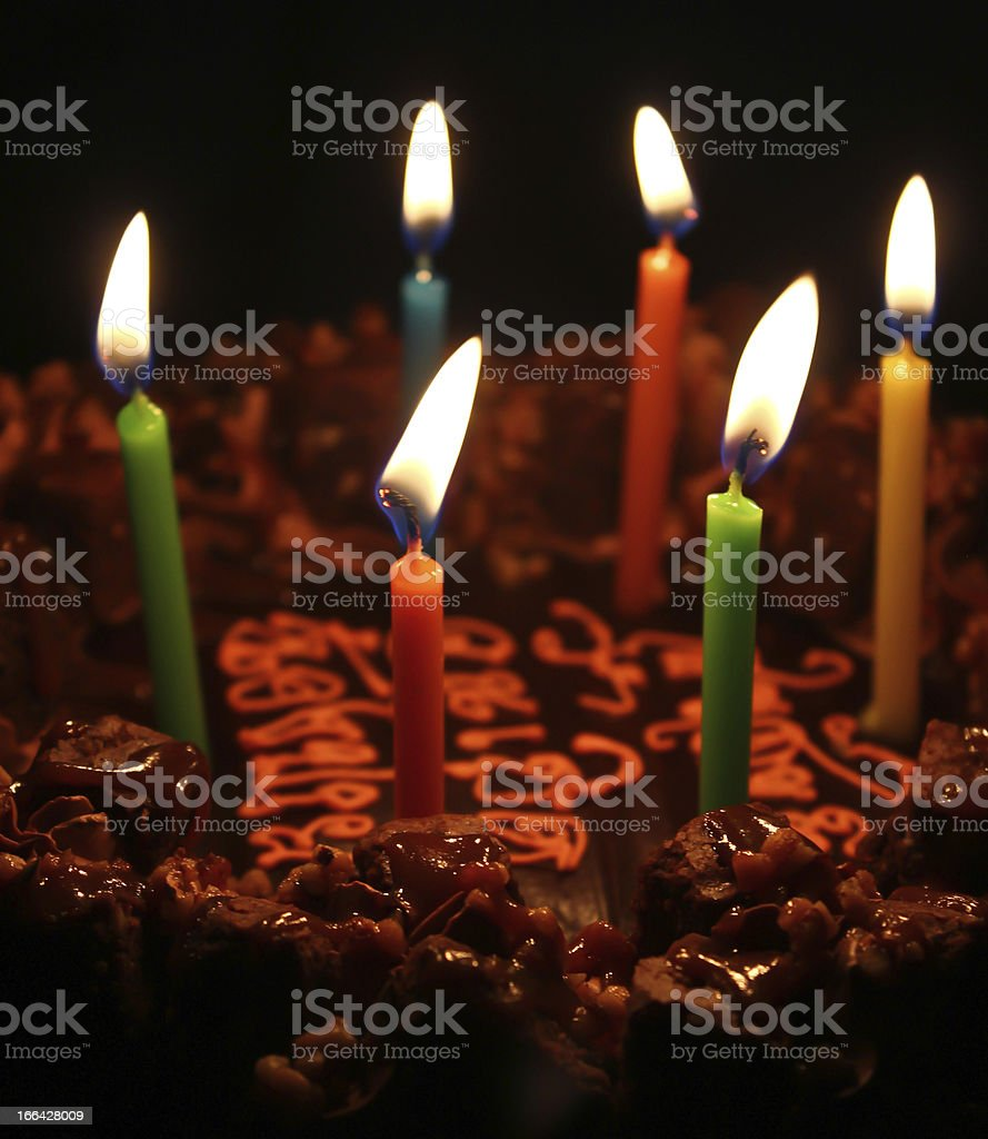 Six Candles on Chocolate Cake royalty-free stock photo