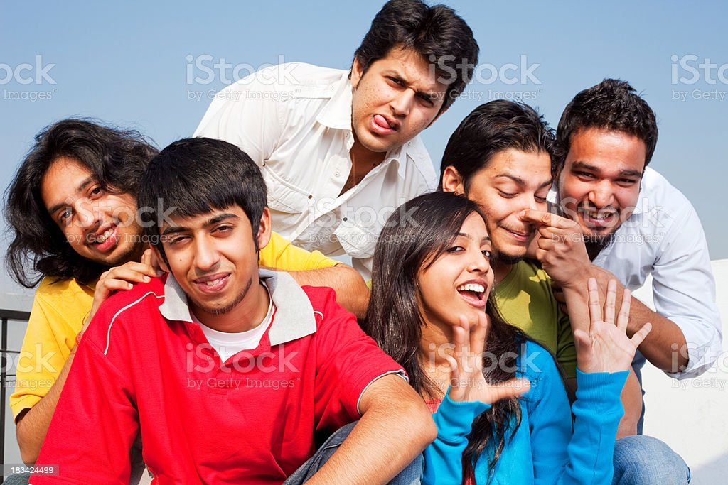 Six Cheerful Excited Indian Friends Having a Fun Time royalty-free stock photo