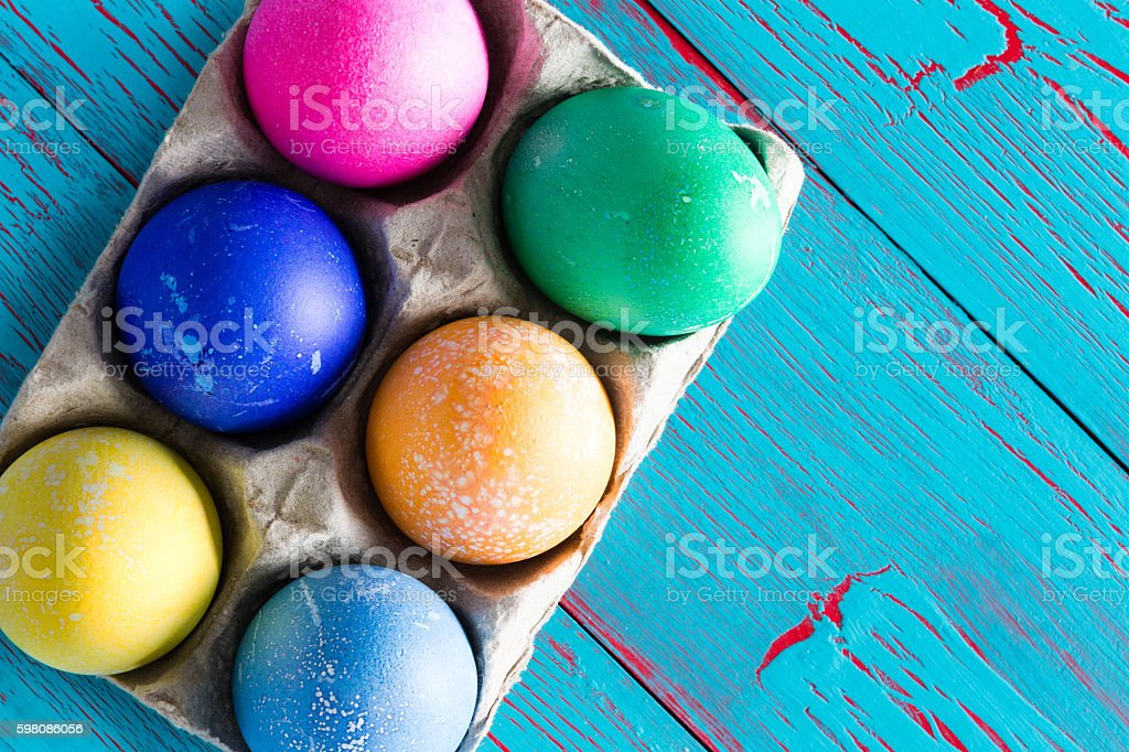 Six colored dyed Easter eggs with copy space stock photo