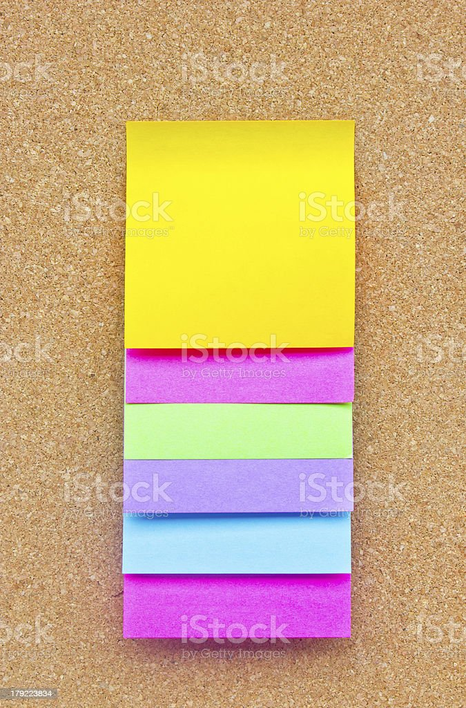 Six colorful sticky notes on wooden board. royalty-free stock photo