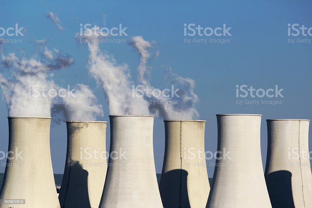 six cooling towers of nuclear power plant stock photo