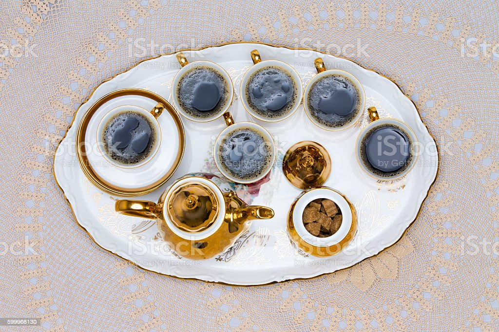 Six Cups of Turkish Coffee Served on White Table stock photo