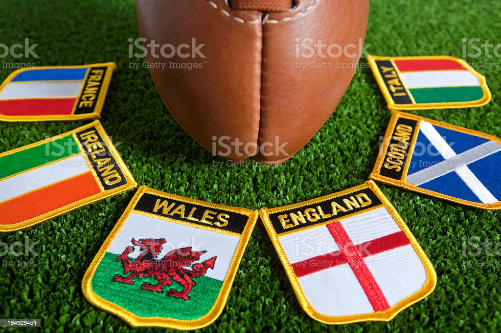 Six different nation's badges for rugby around a rugby ball stock photo