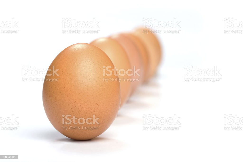 Six eggs lined-up behind each other royalty-free stock photo