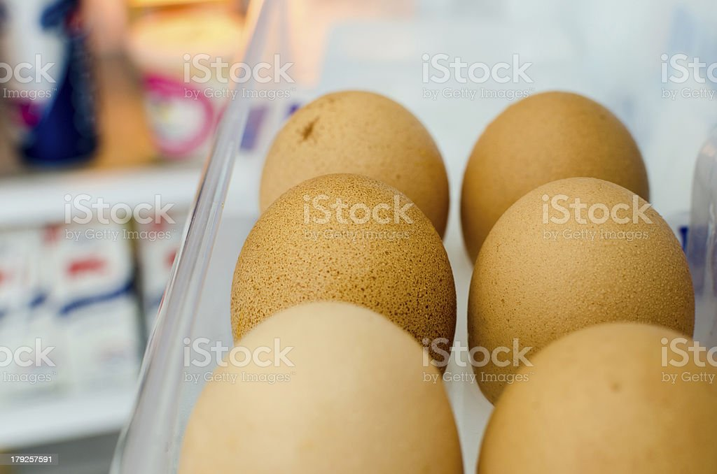 Six eggs stored in the refrigerator door royalty-free stock photo