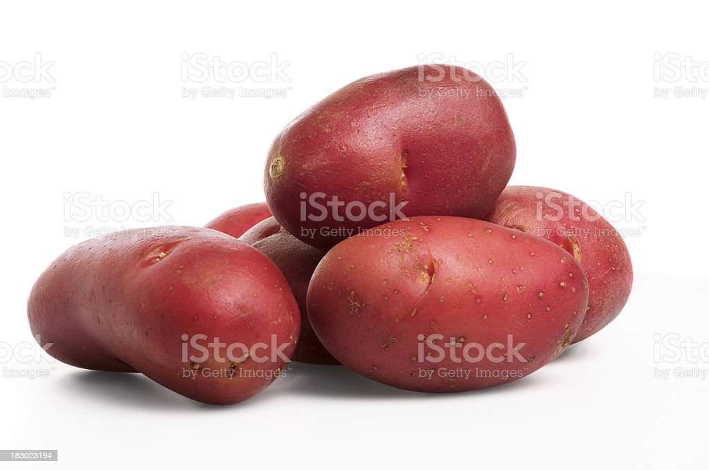 Six fingerling potatoes against a white background stock photo