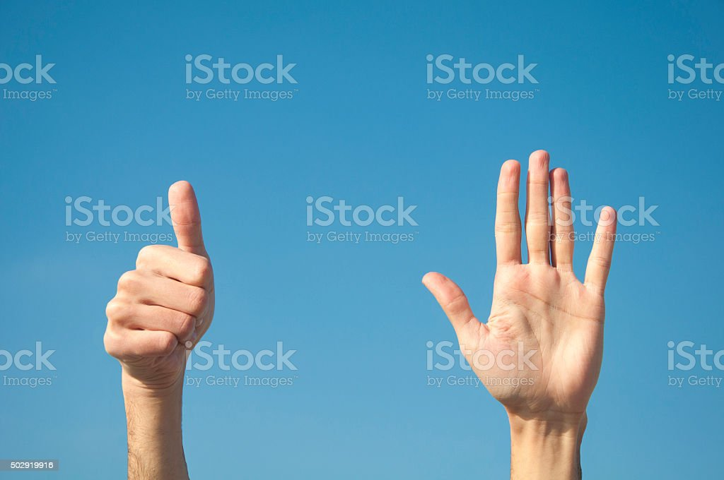 Six fingers with two hands. stock photo