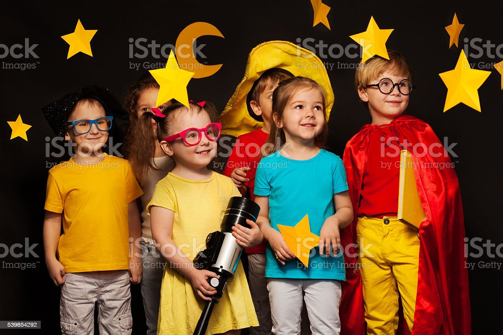 Six friends in sky watcher costumes watching stars stock photo