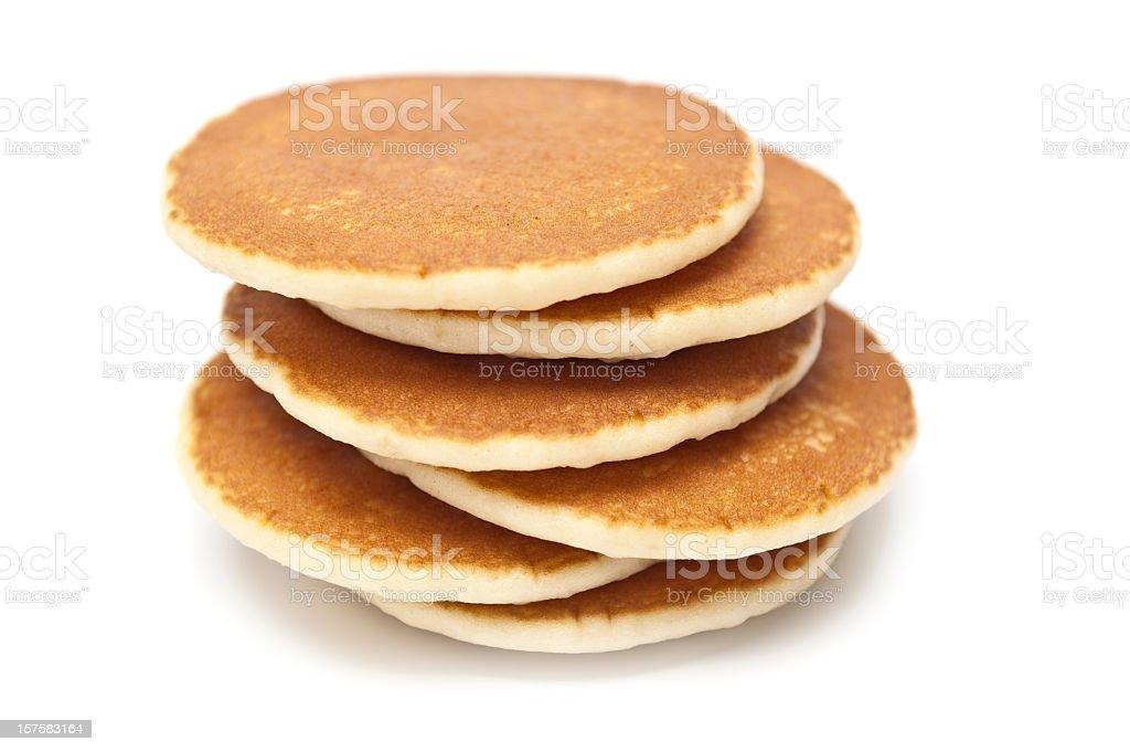 Six golden brown pancakes stacked in uneven arrangement stock photo