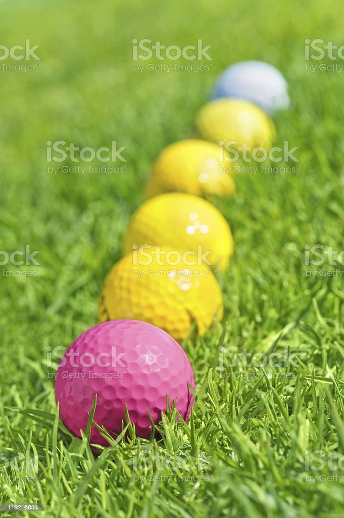 six golf balls on the green grass royalty-free stock photo